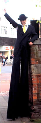 stilt walker handing out leaflets